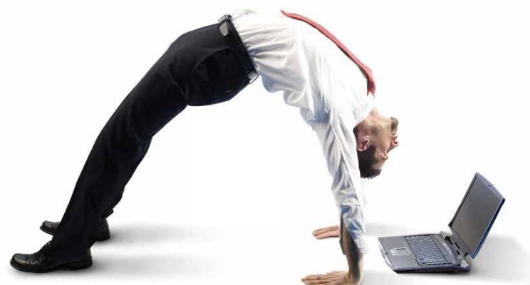 Businessman in white shirt and tie in an arched bridge bending over backwards to work on his laptop